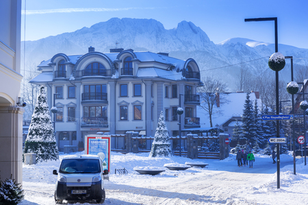 ZAKOPANE, POLAND - DECEMBER 30, 2016: Architecture of Zakopane at winter, Poland. City center of Zakopane is the main shopping area with pedestrian promenade in Tatra mountains. Editorial