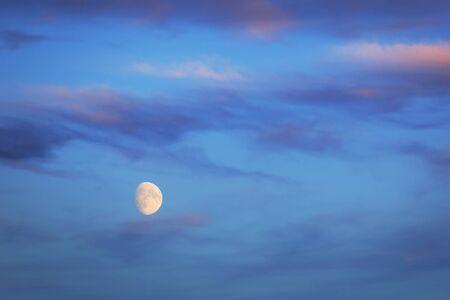 Moon over the blue sky Stock Photo