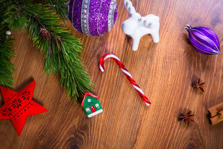 Top view of Christmas spices and decorations on wooden table Stock Photo