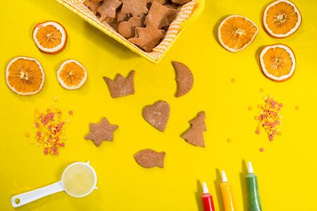 Decorating gingerbread cookies for Christmas Stock Photo