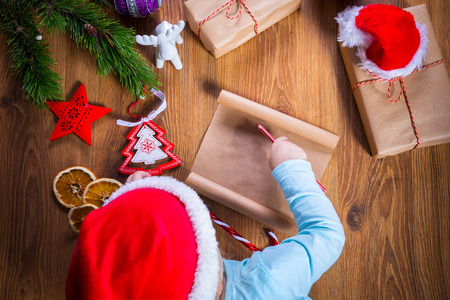 Top view of child writing letter to Santa Claus for Christmas Stock Photo