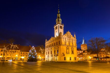 Old town square with historical town hall in Chelmno at night, Poland Stock Photo