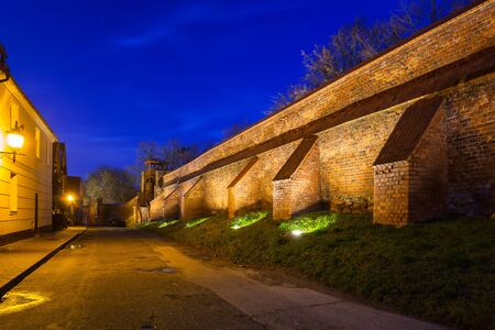 Defensive walls of the old town in Chelmno at night, Poland