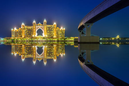 DUBAI, UAE - 31 MARCH 2014: Atlantis hotel iluminated at night in Dubai, UAE. Atlantis the Palm is a luxury 5 star hotel built on an artificial island with over 1,500 guestrooms.