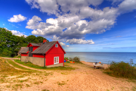 Red cottage house at the beach of  Baltic sea in Sweden