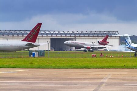SHANNON AIRPORT, IRELAND - JULY 9, 2011: Omni air planes on the runway of Shannon International Airport in Ireland. Omni air is a privately owned American charter airline.