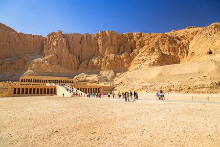 LUXOR, EGYPT - APRIL 10, 2013: Unidentified tourists at The Mortuary Temple of Queen Hatshepsut located near the Valley of the Kings. Temple was dedicated to the sun god Amon-Ra around 1500BC.