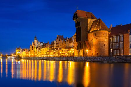 Architecture of the old town in Gdansk over Motlawa river at night, Poland Stock Photo