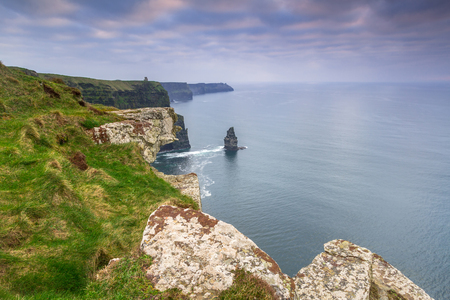 Cliffs of Moher in Ireland at cloudy day, Co. Clare Stock Photo