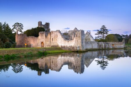 Ruins of the castle in Adare at dusk, Ireland Stock Photo