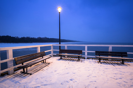 Snowy pier at Baltic Sea in Gdansk, Poland