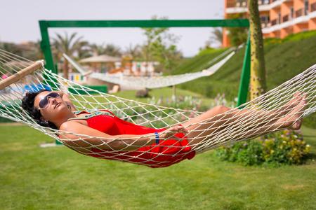 Beautiful woman relaxing on the hammock