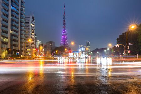 Cityscape of busy street with Tokyo tower at night, Japan