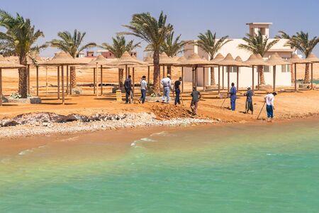 Hurghada, Egypt - April 17, 2013: Workers fixing coastline of tropical resort near Hurghada, Egypt. Hurghada is very popular tourist destination in Egypt.