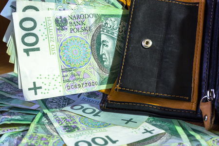 Wallet full of hundred zloty banknotes