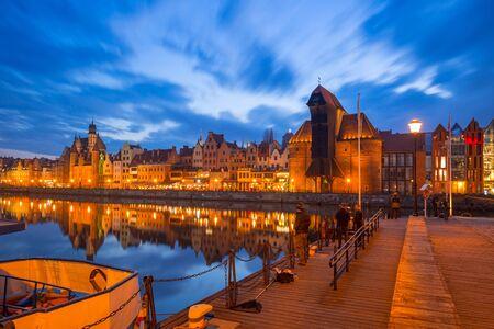 Promenade at Motlawa river and marina in Gdansk at night, Poland