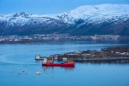 Coastline of Alesund with snowy mountains, Norway