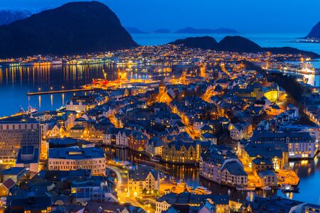 Beautiful Alesund town at night in Norway Stock Photo
