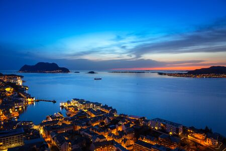 Cityscape of Alesund town at dusk, Norway