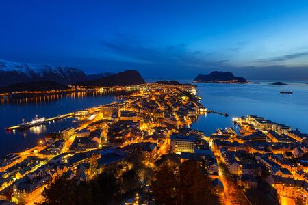 Cityscape of Alesund town at night, Norway