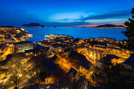 Beautiful Alesund port town at night in Norway Stock Photo
