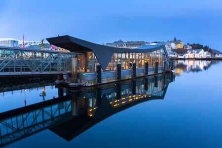 Port of Alesund town reflected in the water, Norway
