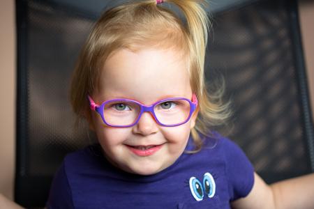 Little girl in glasses portrait