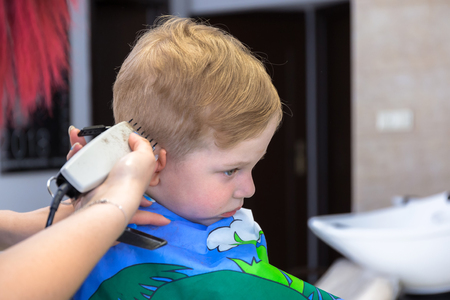 Haircut of three years old boy Stock Photo