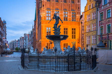Fountain of the Neptune in old town of Gdansk at dawn, Poland