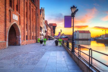 Port crane at Motlawa river in Gdansk at sunrise, Poland