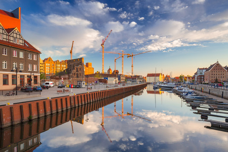 Beautiful marina with yachts in Gdansk reflected in the river at sunrise, Poland. Stock Photo