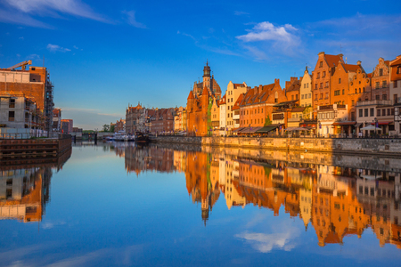 Beautiful old town of Gdansk reflected in Motlawa river at sunrise, Poland. Stock Photo