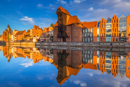 Historic port crane of Gdansk reflected in Motlawa river at sunrise, Poland
