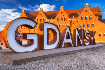 Gdansk city outdoor sign at sunrise, Poland