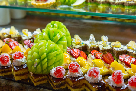 Set of delicious sweet cakes and dessert in the restaurant