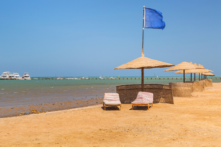 Parasols on the beach of Red Sea in Hurghada, Egypt Stock Photo