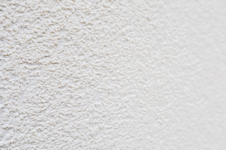 Pattern of white rock plastered stucco wall Stock Photo
