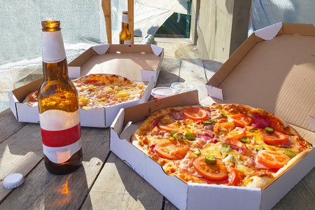 Pizza with beers ion the summer terrace