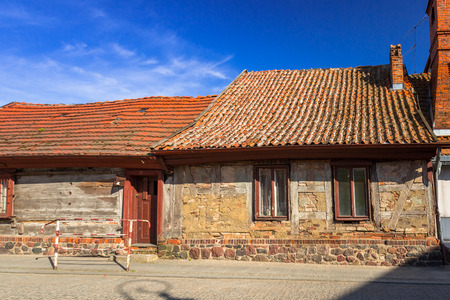Street with old cottage architecture in Golub-Dobrzyn town, Poland