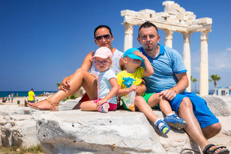 Family with twins visit ancient ruins of Apollo temple in Side, Turkey