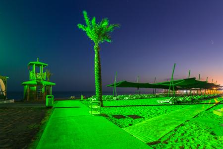 Beach scenery with palm trees at night, Turkey Stock Photo