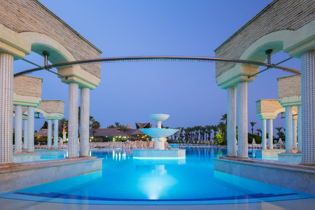 Side, Turkey - June 9, 2018: Beautiful pool area of the TT Pegasos World resort near Side at night, Turkey. Pegasos World Hotel is a 4-star resort with 9600 square metres of pool areas. Editorial