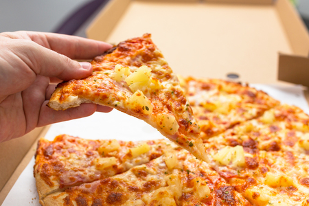 Close up of tasty hawaiian pizza with ham and pineapple Stock Photo