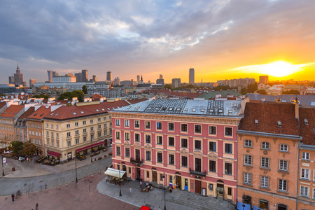 Royal Castle square in Warsaw city at sunset, Poland