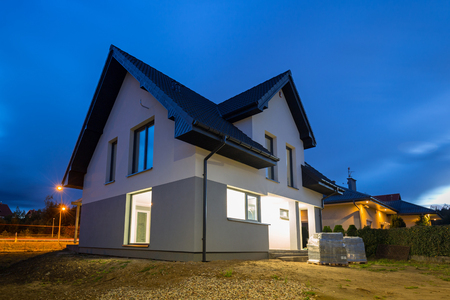 Newly built house illuminated at night Archivio Fotografico