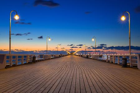 Baltic sea pier in Sopot at sunrise, Poland Stock Photo