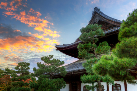 Buddhist temple in Kyoto during autumn season at sunset, Japan