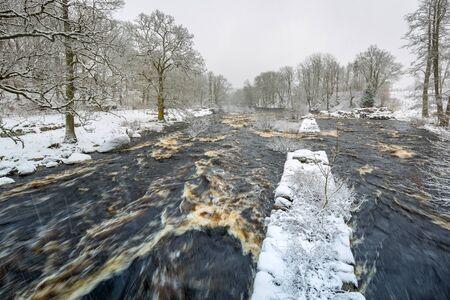 Wild Morrum river in snowy winter, Sweden Stock fotó