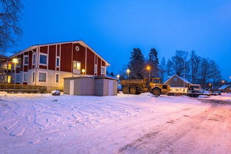 Winter scenery with red wooden house  in Sweden at night