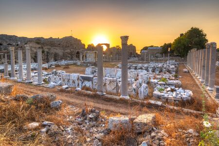 Ruins of the ancient theatre in Side at sunset, Turkey